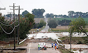 LONGMONT, CO - SEPTEMBER 13: Local residents take in a close up view of a damaged bridge on Weld County Road 1 in Longmont, Colorado as heavy rains for the better part of week fueled widespread flooding in numerous Colorado towns on September 13, 2013. (Photo by Marc Piscotty/ © 2013)