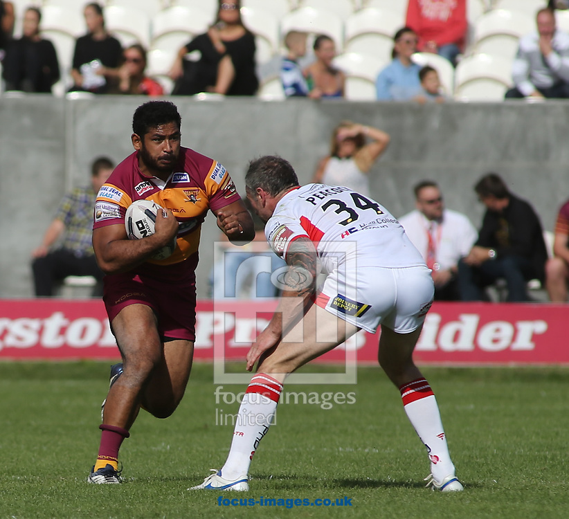 Jamie Peacock of Hull Kingston Rovers tackle Sebastine Ikahihifo (C) of Huddersfield Giants during the Super 8s Qualifiers match at the KC Lightstream Stadium, Kingston upon Hull<br /> Picture by Stephen Gaunt/Focus Images Ltd +447904 833202<br /> 24/09/2016
