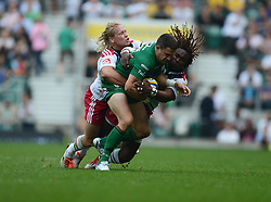 Harlequins Winger Marland Yarde tackles London Irish Outside Centre Fergus Mulchrone- Photo mandatory by-line: Alex James/JMP - 07966 386802 - 06/09/2014 - SPORT - RUGBY UNION - London, England - Twickenham Stadium - Saracens v Wasps - Aviva Premiership London Double Header.