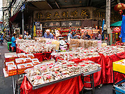 "04 FEBRUARY 2016 - BANGKOK, THAILAND:  New Year snacks for sale in Bangkok's Chinatown district, before the celebration of the Lunar New Year. Chinese New Year, also called Lunar New Year or Tet (in Vietnamese communities) starts Monday February 8. The coming year will be the ""Year of the Monkey."" Thailand has the largest overseas Chinese population in the world; about 14 percent of Thais are of Chinese ancestry and some Chinese holidays, especially Chinese New Year, are widely celebrated in Thailand.     PHOTO BY JACK KURTZ"