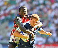 Twickenham, London - Sunday 23rd May 2010: Camille Canivet of France 5 tackled by Dennis Mwanja of Kenya during the Shield Final which Kenya won during the Emirates London Sevens rugby tournament at Twickenham Stadium, London, UK. (Pic by Andrew Tobin/Focus Images)