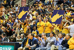 Dec 5, 2017; Morgantown, WV, USA; West Virginia Mountaineers students cheer during the first half against the Virginia Cavaliers at WVU Coliseum. Mandatory Credit: Ben Queen-USA TODAY Sports