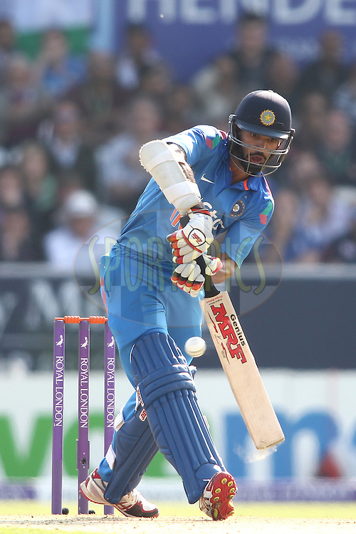 Shikhar Dhawan of India looks to play a delivery through the leg side during the 5th One Day International ( ODI ) match between England and India held at Headingley Cricket Ground in Leeds, England on the 5th September 2014<br /> <br /> Photo by Shaun Roy / SPORTZPICS/ BCCI
