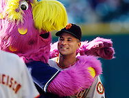Indians mascot  Slider gives Omar Vizquel a hug during his pregame workout at Progressive Field in Cleveland.