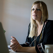 FORT MYERS, FLORIDA, JANUARY 29, 2017<br /> Erin Fahs, 33, uses her computer to have a conference call with two new interns in the company she works for called The Collective Good which does consulting for non profit organizations. Fahs works from her home and got her job using a new company called Werk which connects employees with high level jobs. <br /> (Photo by Angel Valentin/Freelance)