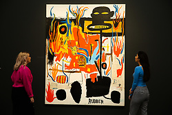 © Licensed to London News Pictures. 07/02/2020. London, UK. Staff members view Jean-Michel Basquiat's painting titled 'Rubber' (Est. £6-£8 million) at the preview of Sotheby's Contemporary Art. The auction will take place at Sotheby's in central London on 11 and 12 February 2020. Photo credit: Dinendra Haria/LNP