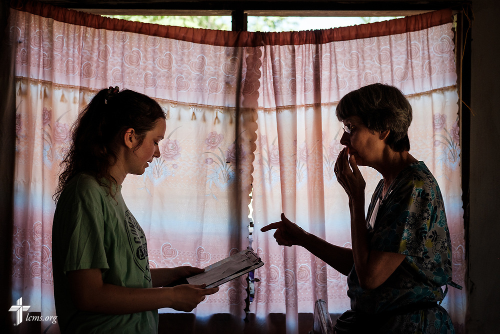 Hayden Rensner, a student at Concordia University, Nebraska, and Bonnie Hartman, a member of Faith Lutheran Church, Godfrey, Ill., prepare for patients on the second day of the LCMS Mercy Medical Team on Tuesday, May 8, 2018, in the Yardu village outside Koidu, Sierra Leone, West Africa. LCMS Communications/Erik M. Lunsford