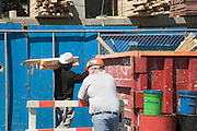 construction site one working other watching