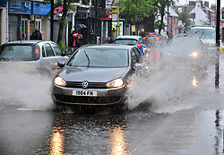 &copy; Licensed to London News Pictures. 6/06/2017<br /> The roads start to flood in Orpington, High Street,Kent.<br /> Heavy rain and some flooding this morning in Kent and the South East,UK. Shoppers and commuters get wet in Orpington High Street as the roads start to flood.<br /> Photo credit: Grant Falvey/LNP