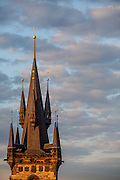 One tower of the Tyn Church located at Old Town Square during sundown.