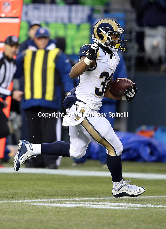 St. Louis Rams running back Todd Gurley (30) runs the ball during the 2015 NFL week 16 regular season football game against the Seattle Seahawks on Sunday, Dec. 27, 2015 in Seattle. The Rams won the game 23-17. (©Paul Anthony Spinelli)