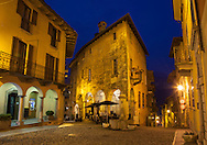 The historic Hotel Pironi is illuminated at night. The hotel, located in the village of Cannobio, is a short walking distance to Lake Maggiore.
