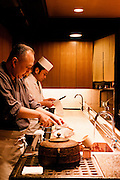 Michihiro Kigawa preparing food at open kitchen at Kigawa restaurant.