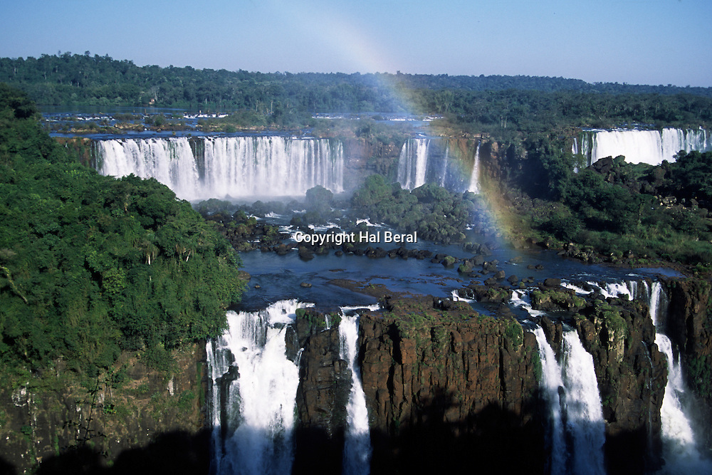 Mist from Iguazu Falls creates a rainbow<br /> Foz do Iguacu, Brazil