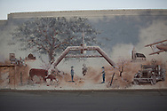 Mural of the welcome sign in Cuhsing Oklahoma on a building in the city's downtown.