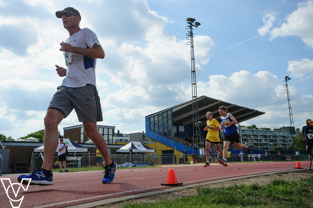 Metro Blind Sport's 2017 Athletics Open held at Mile End Stadium.  5000m.  David Beynon, left, and Tom Skelton with guide runner<br /> <br /> Picture: Chris Vaughan Photography for Metro Blind Sport<br /> Date: June 17, 2017