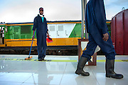 Cleaners get to work at the turnaround when the new Nairobi Commuter Railway train is waiting at the new Syokimau Railway Station, 18kms outside Nairobi's city centre. Costing KSh.400 million the new railway system which includes Syokimau and Nairobi Railway Stations was launched by Kenya's President Mwai Kibaki on Tuesday 13th November 2012 marking the next stage of railway development in the country since the earliest accounts of Nairobi's history dating back to 1899. Costing Sh120 one way passengers cover the 18-kilometre journey in a comfortable 30 minutes.