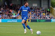 AFC Wimbledon defender Luke O'Neill (2) looking over his shoulder and about to pass the ball during the EFL Sky Bet League 1 match between AFC Wimbledon and Wycombe Wanderers at the Cherry Red Records Stadium, Kingston, England on 31 August 2019.