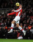 Robin Van Persie controls the ball during the FA Cup 4th Round Replay between Arsenal and Cardiff City at the Emirates Stadium on February 16, 2009 in London, England.
