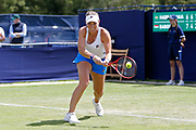 Timea Babos of Hungary plays a backhand during the during the Women's Singles Quarter Final at the Fuzion 100 Ilkley Lawn Tennis Trophy Tournament held at Ilkley Lawn Tennis and Squad Club, Ilkley, United Kingdom on 19 June 2019.