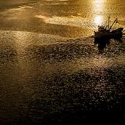 Fishing boat against reflection. Juneau, Alaska.