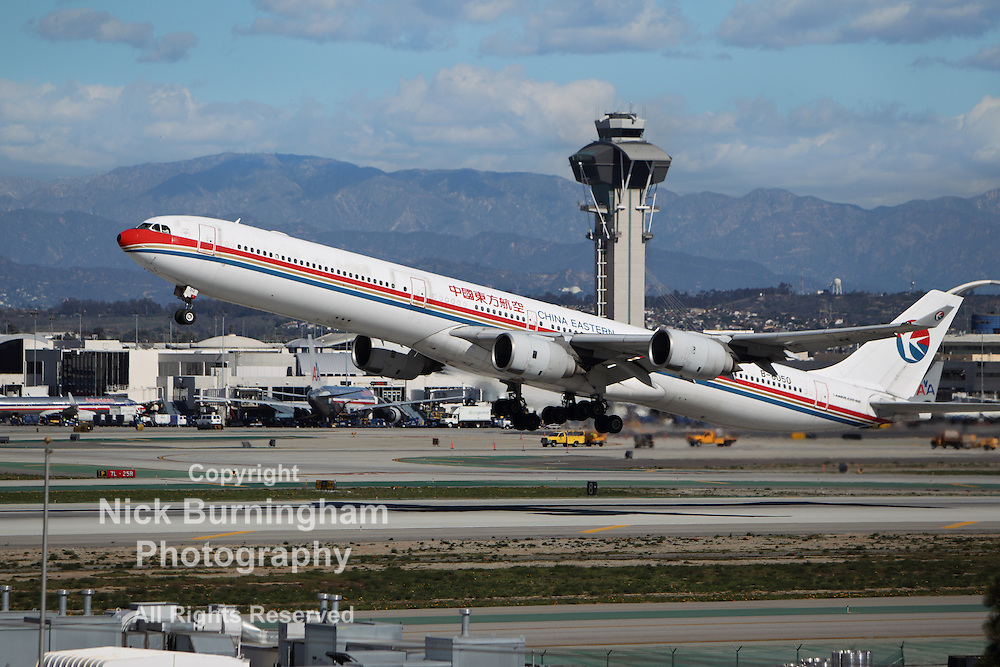 LOS ANGELES, CALIFORNIA, USA - JANUARY 28, 2013 -  China Eastern Airlines Airbus A340-642 takes off from Los Angeles Airport on January 28, 2013. The plane has a range of range 13,900 km with 379 passengers.