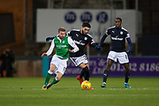 24th January 2018, Dens Park, Dundee, Scottish Premiership, Dundee versus Hibernian; Hibernian's Martin Boyle battles for the ball with Dundee's Faissal El Bakhtaoui