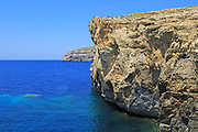 Coastal scenery cliffs of former Azure Window arch now collapsed, Dwerja Bay, island of Gozo, Malta