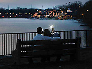 Rashad & Michelle Love share a tender moment enjoying 74 degree weather at sunset along the Schuylkill river and Boathouse Row as they take their own photo.