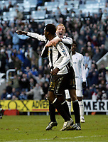 Photo: Andrew Unwin.<br />Newcastle United v Bolton Wanderers. The Barclays Premiership. 04/03/2006.<br />Newcastle's Shola Ameobi (L) celebrates his goal with Peter Ramage (R).