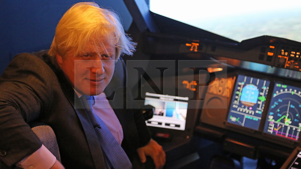 © Licensed to London News Pictures. 05/07/2013. Greenwich, United Kingdom. The Mayor of London Boris Johnson joined Emirates boss Tim Clark to launch a new Aviation Experience next to the cable car at North Greenwich. The experience includes various flight simulators and a model of the nose of an A380. credit : Rob Powell/LNP
