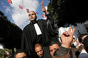 A lawyer that joins the demonstration is acclaimed by the crowd.Tunisians from province still camp under the the Prime Minister's office demanding the dissolution of the interim governement.