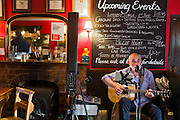Live music entertainment, with a man playing guitar and singing, is being provided at The Durham Ox restaurant, in Crayke, Yorkshire, England, United Kingdom.