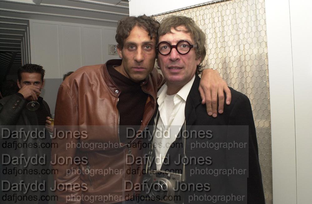 Jamie Morgan, Johnny Rozca. Talk pre-globe Awards Party. Mondrian, Los Angeles. 22/1/2000. <br />© Copyright Photograph by Dafydd Jones 66 Stockwell Park Rd. London SW9 0DA Tel 0171 733 0108 www.dafjones.com