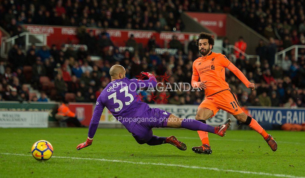 STOKE-ON-TRENT, ENGLAND - Wednesday, November 29, 2017: Liverpool's Mohamed Salah scores the third goal making the score 3-0 during the FA Premier League match between Stoke City and Liverpool at the Bet365 Stadium. (Pic by Peter Powell/Propaganda)