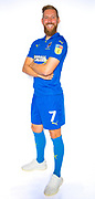 AFC Wimbledon midfielder Scott Wagstaff (7) during the official team photocall for AFC Wimbledon at the Cherry Red Records Stadium, Kingston, England on 8 August 2019.