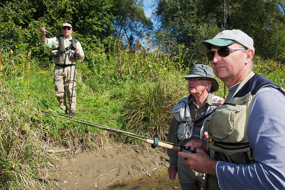 Jeremy Lucas (Pioneer Flyfishing Ltd) guiding Lawrence Greasley and Stuart Crooks (on the bank) for Grayling (Thymallus thymallus) fishing at the San River. Myczkowce, Poland.