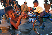CAMBODIA: Phnom Penh.Children playing on the waterfront of the Tonle Sap