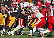 November 23 2012: Iowa Hawkeyes running back Mark Weisman (45) runs into a wall of Nebraska Cornhuskers defenders during the second half of the NCAA football game between the Nebraska Cornhuskers and the Iowa Hawkeyes at Kinnick Stadium in Iowa City, Iowa on Friday November 23, 2012. Nebraska defeated Iowa 13-7 in the Heroes Game on Black Friday.