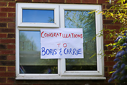 © Licensed to London News Pictures. 29/04/2020. London, UK. A well-wisher in north London displays a 'CONGRATULATIONS TO BORIS & CARRIE' sign in a window following the announcement of the birth of Prime Minister Boris Johnson and his fiancee Carries Symonds' son. Photo credit: Dinendra Haria/LNP