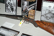 Display of Teddy Roosevelt's Fox shotgun, showing scratches in the stock from Roosevelt's use of the gun, at the James D. Julia auction house in Fairfield, Maine.