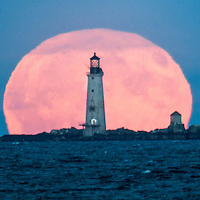 September 16, 2016-Boston,MA. The full Harvest moon rises over Boston Harbor's Graves Light Friday evening. Staff photo by Mark Garfinkel