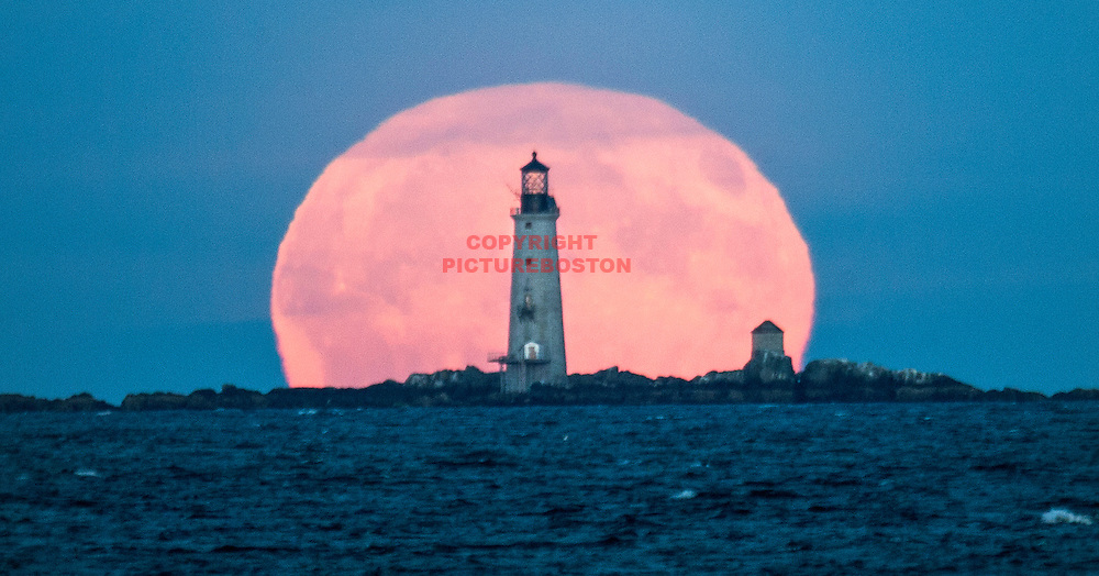 September 16, 2016-Boston,MA. The full Harvest moon rises over Boston Harbor's Graves Light Friday evening. Staff photo by Mark Garfinkel
