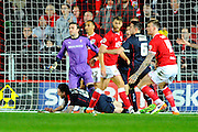 Rotherham United defender Greg Halford falls to the ground with a head injury during the Sky Bet Championship match between Bristol City and Rotherham United at Ashton Gate, Bristol, England on 5 April 2016. Photo by Graham Hunt.