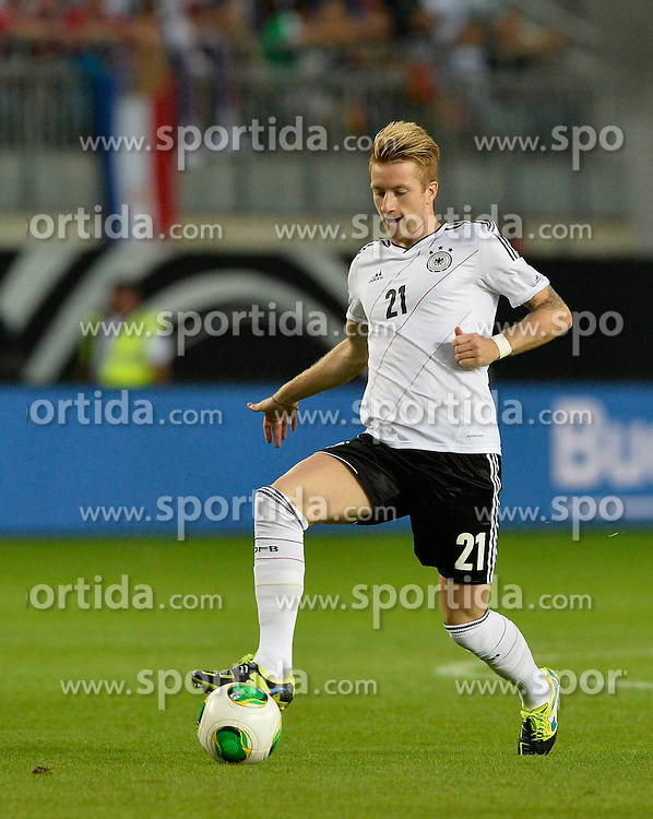 14.08.2013, Fritz Walter Stadion, Kaiserslautern, GER, Testspiel, Deutschland vs Paraguay, im Bild Marco Reus (GER) am Ball Freisteller, Einzelbild, Aktion // during the international friendly match between Germany and Paraguay at Fritz Walter Stadium, Kaiserslautern, Germany on 2013/08/14. EXPA Pictures &copy; 2013, PhotoCredit: EXPA/ Eibner/ Michael Weber<br /> <br /> ***** ATTENTION - OUT OF GER *****
