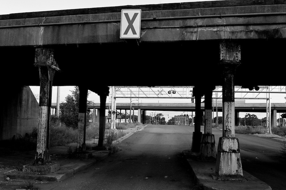 """Pictured is an overpass near the U.S. Steel plant in Gary, Indiana. The Environmental Protection Agency is currently suing U.S. Steel Corp., alleging violations of the Federal Clean Air Act. The city of roughly 80,000 was founded in 1906 by the U.S. Steel Corporation as the home for its new plant. But in the 1960s Gary's fortunes, so closely linked to the steel industry, took a downturn. Businesses closed and the crime rate spiraled earning Gary the infamous distinction of """"Murder Capital of America."""" (© William B. Plowman/Redux)"""