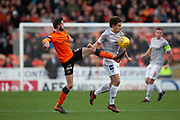 12th January 2019, Tannadice Park, Dundee, Scotland; Scottish Championship football, Dundee United versus Dunfermline Athletic; Sam Stanton of Dundee United challenges for the ball with Joe Thomson of Dunfermline Athletic
