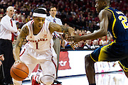 January 9, 2014: Deverell Biggs (1) of the Nebraska Cornhuskers drives the baseline against Caris LeVert (23) of the Michigan Wolverines at the Pinnacle Bank Areana, Lincoln, NE. Michigan defeated Nebraska 71 to 70.