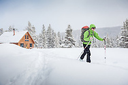Heather Hudson of Boulder, Colorado, heads out on a day of backcountry skiing during her multi-night stay at the McNamara Hut in Colorado.