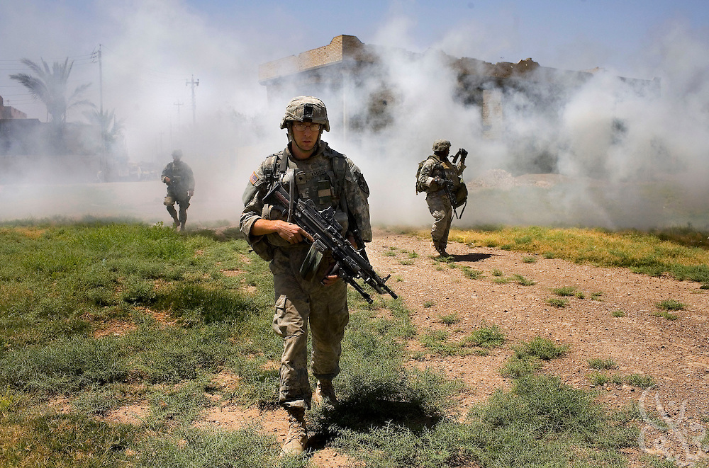U.S. Army 1-23 Stryker soldiers abandon their stronghold position under the cover of a smoke screen after finding a house rigged with explosives next door during a clearing operation June 23, 2007 in Baquba, Iraq. U.S. and Iraqi soldiers continue to clear homes in Baquba in search of an estimated 300-500 Al Qaeda fighters, but many appear to have fled the city prior to the operation.  ...